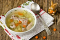 Dietary soup with rabbit and carrots helpful on a wooden table Royalty Free Stock Photo