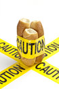 Dietary warning or gluten wheat allergy warning fresh french bread wrapped in yellow caution tape Stock Image