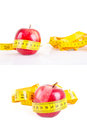 Dieting concept apple with measuring tape on white background Royalty Free Stock Photography