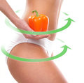 Dieting concept beautiful belly and a fruit isolated on white green arrows pepper Royalty Free Stock Image