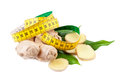 Dieting concept ginger with measuring tape Stock Photography