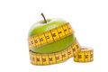 Dieting concept Green apple with measuring tape Royalty Free Stock Images