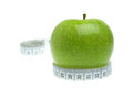 Dieting concept measurement and apple fruit Royalty Free Stock Photography