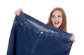 Dieting concept with oversize jeans Royalty Free Stock Photo