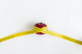 Dieting concept. Red apple with yellow measuring tape isolated on white Royalty Free Stock Photo