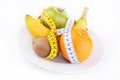 Dieting fruit on plate and meter Royalty Free Stock Photography