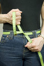 Dieting, tape measure as belt Stock Photos