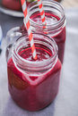 Dieting and well being concept, berry smoothie in jar Royalty Free Stock Photo