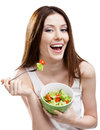 Dieting woman eating salad Stock Image