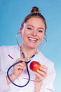 Dietitian examine apple fruit with stethoscope disgusted nutritionist checking woman food good healthy eating nutrition Royalty Free Stock Image