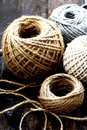 Diferent balls of string on wooden table Stock Photography