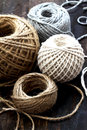 Diferent balls of string on wooden table Stock Images