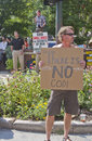 Difference of religion asheville north carolina usa july christians and an athiest hold conflicting signs on july at the downtown Stock Photo