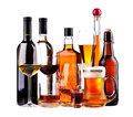 Different alcoholic drinks bottles and glasses of isolated on a white background Royalty Free Stock Image