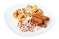Different appetizer to beer on a dish with snacks crispy bacon chicken wings croutons with garlic parmesan cheese pork loin fries Stock Photos