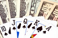 Different banknotes and poker cards Royalty Free Stock Image