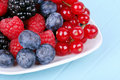 Different berries on plate Royalty Free Stock Image