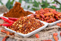 Different chillies portions of chilli spices Stock Photos