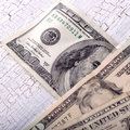 Different dollar bills on wooden table Royalty Free Stock Images
