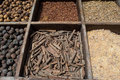 Different eastern spices in sections for sale at arabian market place Stock Photos