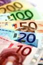 Different euro bills are spread out on a table in the form of a Royalty Free Stock Photo