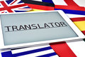 Different flags and the word translator in the screen of a table Royalty Free Stock Photo