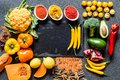 Different Fresh colorful organic vegetables. healthy raw vegan food on grey background with free copy space. Flat lay Royalty Free Stock Photo