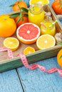 Different fruits and glass with fresh orange juice Royalty Free Stock Photo