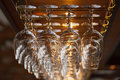 Different glasses hanging over the bar. Soft focus. Royalty Free Stock Photo