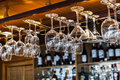Different glasses hanging over the bar. Soft focus. selective focus. Royalty Free Stock Photo