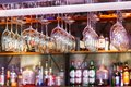 Different glasses hanging over the bar. Soft focus. selective focus Royalty Free Stock Photo