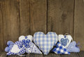 Different handmade blue hearts of fabric on a wooden background Royalty Free Stock Photography