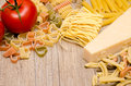 Different italian pasta pecorino and red tomato on wood Stock Photos