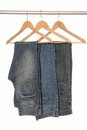 Different jeans are on hangers woody Royalty Free Stock Images