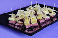 Different kinds of ham  and cheese gauda arranged ready to be served for a party Royalty Free Stock Photo