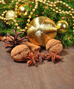 Different kinds of spices, nuts, cone and Christmas decorations Royalty Free Stock Photo