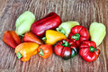 Different kinds of sweet peppers on grunge wooden background.Ton Royalty Free Stock Photo