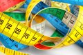 Different measuring tapes, closeup Royalty Free Stock Photo