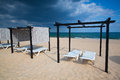 Different parasols and sun loungers on the empty beach on tavira island before storm algarve portugal Royalty Free Stock Images