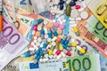 Image : Different pills and drugs on euro bills exchange  many