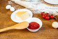 Different pizza ingredients, tomato paste and cheese