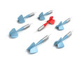 Different red dart arrow out from others blue set