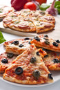 Different sliced pizzas with ingredients Royalty Free Stock Photo