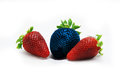 Different than the rest alone blue strawberry.Concept for genetically modified food Royalty Free Stock Photo