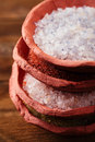 Different type of salt in rustic clay bowls Royalty Free Stock Photo