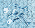Different types of keys on the puzzle close up in cold tones Stock Photography