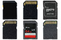 Different types of removable flash memory cards and micro sd ada adapter isolated on white Stock Photos