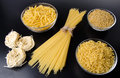 Different types of uncooked pasta on a black background Stock Images