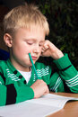 Difficult school homework schoolboy doing his with problems Royalty Free Stock Image