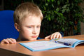Difficult school homework tired boring boy don t want to do his Stock Photography